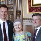 Tessa Jowell with Health Secretary Jeremy Hunt and shadow health secretary Jonathan Ashworth in the House of Commons ahead of the debate (The Brain Tumour Charity/PA)