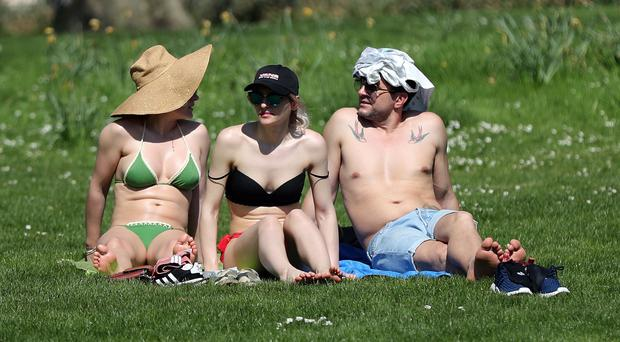 People enjoy the hot weather in St. James's Park, London (Gareth Fuller/PA)