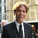 Cliff Richard arrives at a court buiding