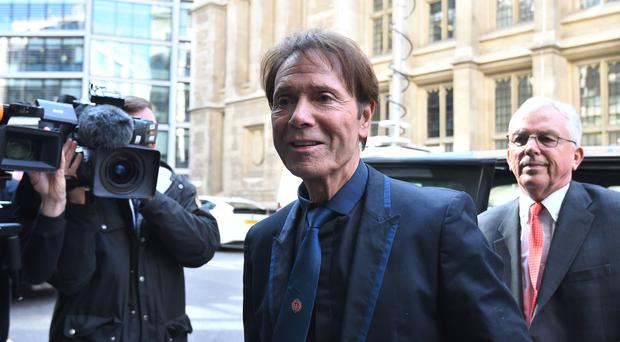 Sir Cliff Richard is suing the BBC over their coverage of a police search of his home (Kirsty O'Connor/PA)