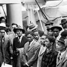 Jamaican immigrants are welcomed by RAF officials from the Colonial Office (PA)