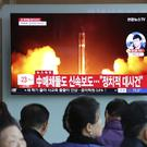 People in South Korean capital Seoul watch a TV showing a file footage of North Korea's missile launch (AP)