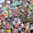 Competitors taking part in the London Marathon (PA)