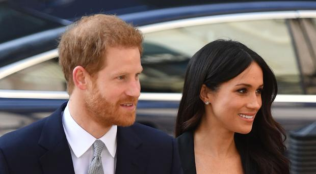 Prince Harry and Meghan Markle arrive at a reception celebrating the forthcoming Invictus Games in Sydney (Dominic Lipinski/PA)