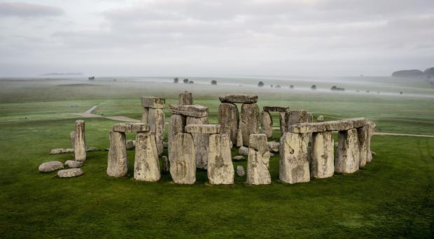 Stonehenge experts have criticised plans to put the road past the stones into a tunnel (Ben Birchall/PA)