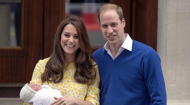 The Duke and Duchess of Cambridge with newborn Princess Charlotte in 2015 (Anthony Devlin/PA)