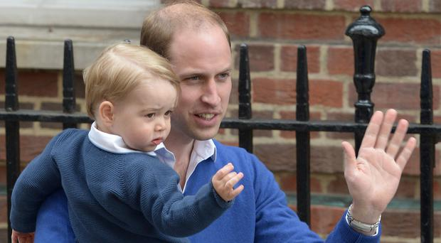 The Duke of Cambridge with his son Prince George as he arrives at the Lindo Wing to see Princess Charlotte in 2015 (Anthony Devlin/PA)