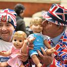 Royal fans John Loughrey, left, and Terry Hutt hold dolls outside the Lindo Wing (Dominic Lipinski/PA)