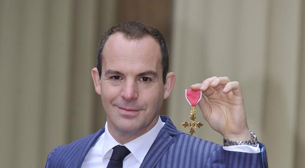 Money Saving Expert Martin Lewis with his OBE after an investiture at Buckingham Palace (Nick Ansell/PA)