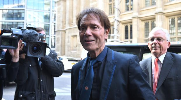 Sir Cliff Richard arrives for his court case (Kirsty O'Connor/PA)
