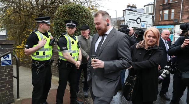 Mark Meechan arrives at Airdrie Sheriff Court for sentencing after he was found guilty of an offence under the Communications Act for posting a YouTube video of a dog giving Nazi salutes (Andrew Milligan/PA)