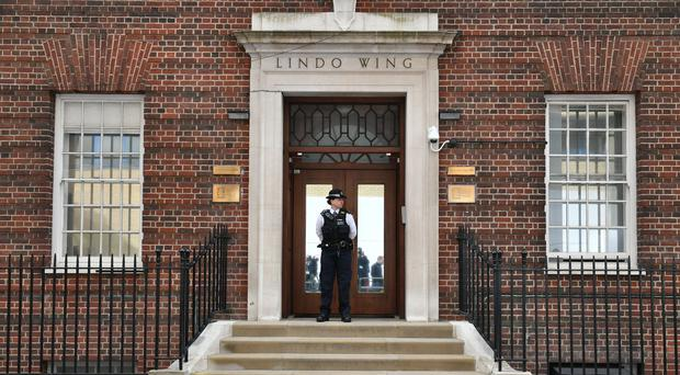 A police officer stands outside the Lindo Wing at St Mary's Hospital in Paddington, London, where the Duchess of Cambridge has been admitted to the hospital in the early stages of labour (Dominic Lipinski/PA)