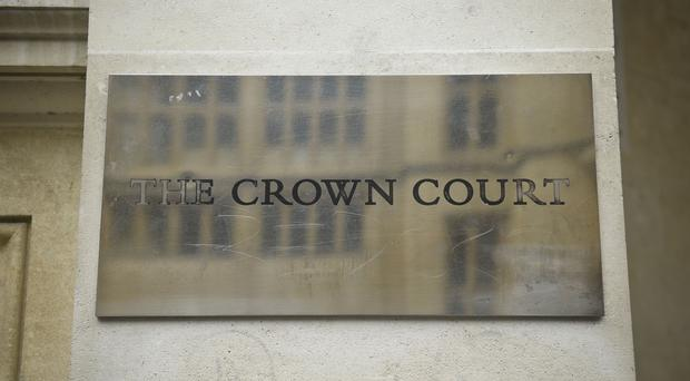 Hannah Henry and Alistair Walker are on trial at Bristol Crown Court over the death of Ah'Kiell Walker (PA)