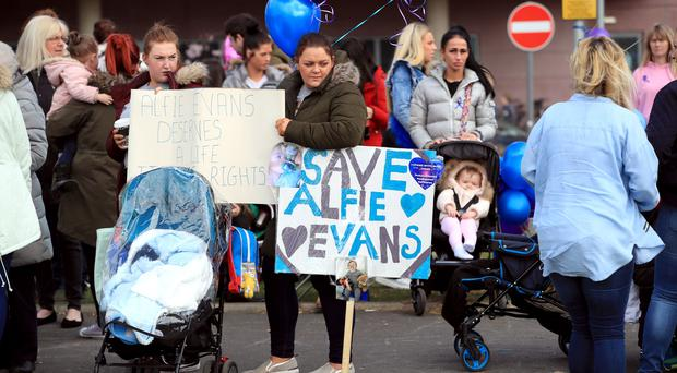 Protesters gather outside Alder Hey Children's Hospital in Liverpool (John Stillwell/PA)