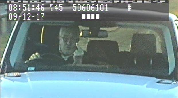 Timothy Hill gestures at a speed camera (North Yorkshire Police/PA)
