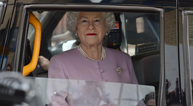 The waxwork of the Queen is driven past the Lindo Wing at St Mary's Hospital (Kirsty O'Connor/PA)