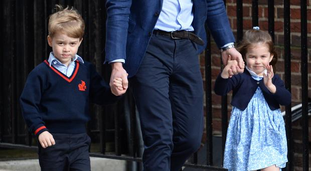 The Duke of Cambridge with Prince George and Princess Charlotte arriving at the Lindo Wing at St Mary's Hospital (Kirsty O'Connor/PA)