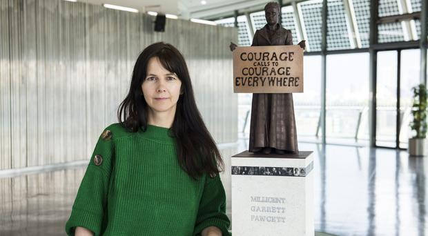 Artist Gillian Wearing with a model of suffragist leader Millicent Fawcett (Caroline Teo/GLA/PA)
