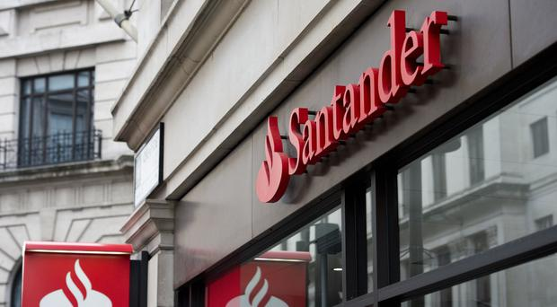 Santander revealed a 21% profit slump as it took another hit from failed construction giant Carillion and suffered amid 'competitive pressures' (Laura Lean/PA)
