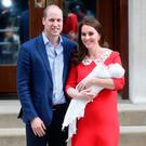 Prince William and the Duchess of Cambridge with their baby son