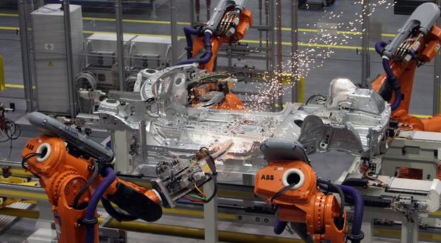 Robots on a production line (Steve Parsons/PA)