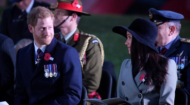 Prince Harry and his fiancee Meghan Markle attend the Dawn Service (Toby Melville/PA)