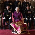 The Queen poses for a photograph after presenting the regiment with their new standard (Steve Parsons/PA)