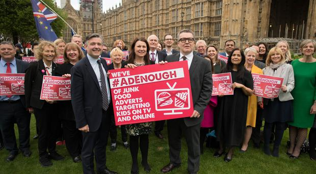 Labour MPs and peers supporting the campaign to stop junk food ads before the watershed (Stefan Rousseau/PA)