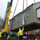 The final 'NestHouses' have been craned into place in the Social Bite Village in Edinburgh (Stewart Attwood/PA)