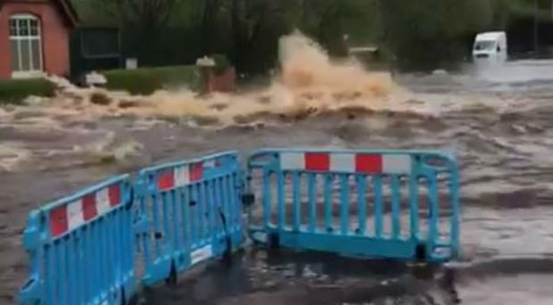 Water pumping out of the ground at Leabrook Road North in Wednesbury (Sandwell Council/PA)