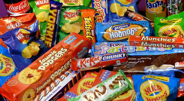 Adding 10% to the price of chocolate, confectionery, cakes and biscuits could lead to a drop in purchases, researchers said (PA)
