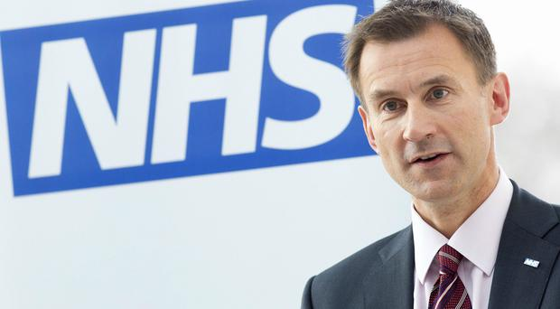 Jeremy Hunt has called on US academic Eric Topol to carry out a review into how the NHS can pioneer new treatments (Neil Hall/PA)