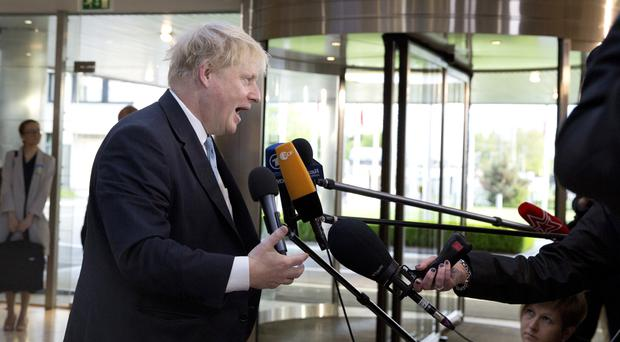 Boris Johnson speaks with the media as he arrives for a meeting of Nato foreign ministers in Brussels (Virginia Mayo/AP)