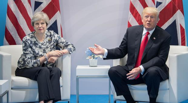 Theresa May held talks with Mr Trump on the margins of the G20 summit (Stefan Rousseau/PA)