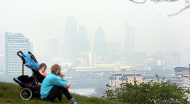 London is among the UK cities that regularly breach air quality standards (Stefan Rousseau/PA)
