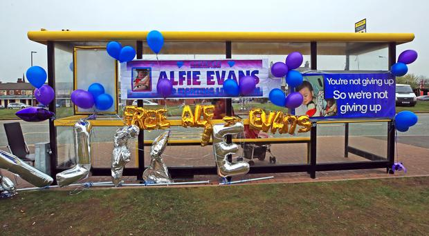 Balloons and banners tied to a bus stop outside Liverpool's Alder Hey Children's Hospital (Peter Byrne/PA)