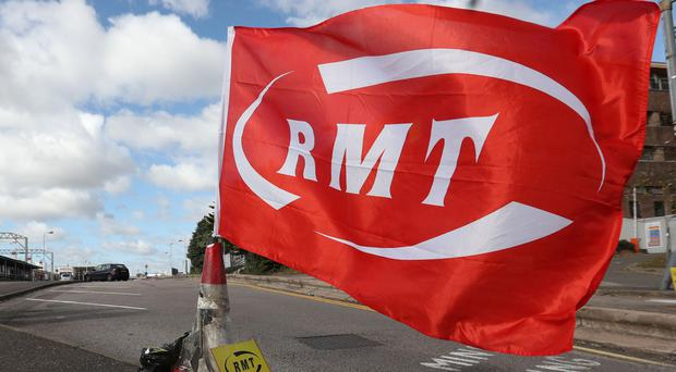 Talks will be held in the bitter dispute between South Western Railway and the RMT(Jonathan Brady/PA)