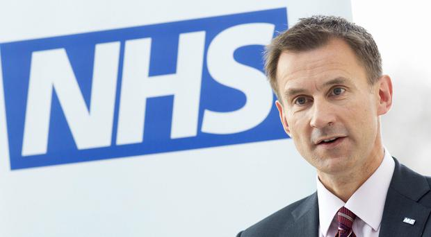 Health Secretary Jeremy Hunt said a 'computer algorithm failure' was to blame (Neil Hall/PA)