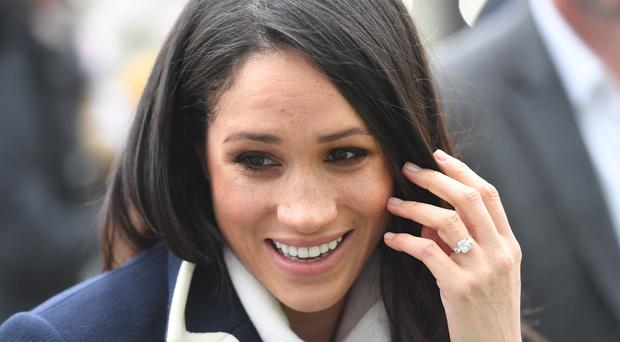 Meghan Markle with her engagement ring on display which will soon be joined by a wedding band. (Victoria Jones/PA)