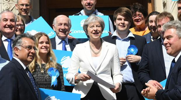 Theresa May with supporters during a visit to Wandsworth Town Hall, London, where the Conservative Party retained control of Wandsworth Council (Stefan Rousseau/PA)
