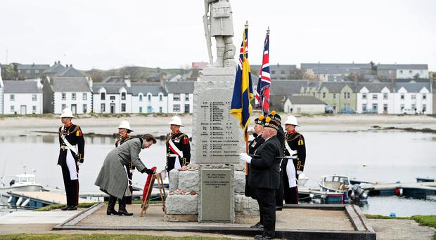 The Princess Royal lays a wreath during a commemoration service at the war memorial in Islay (Jane Barlow/PA)