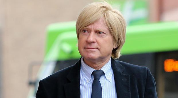 Tory MP Michael Fabricant has defended calling someone 'a complete twat' on Twitter (Peter Byrne/PA)