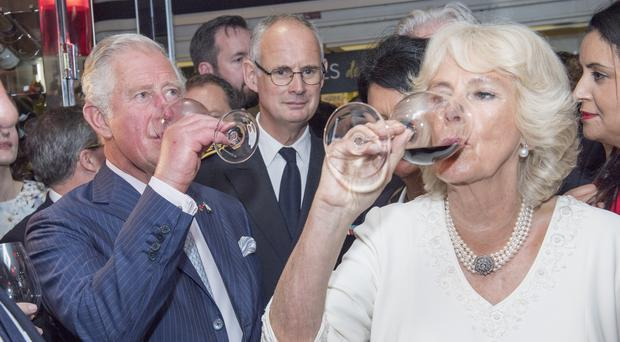 Charles and Camilla try some wine in Lyon (PA)