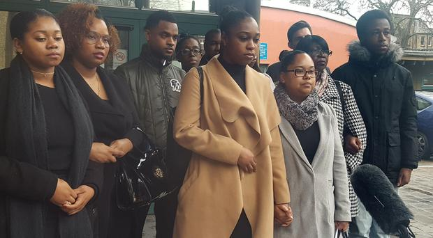 The family of Kevin Clarke speaks outside Southwark Coroner's Court in London in March, when the inquest into his death was opened (Catherine Wylie/PA)