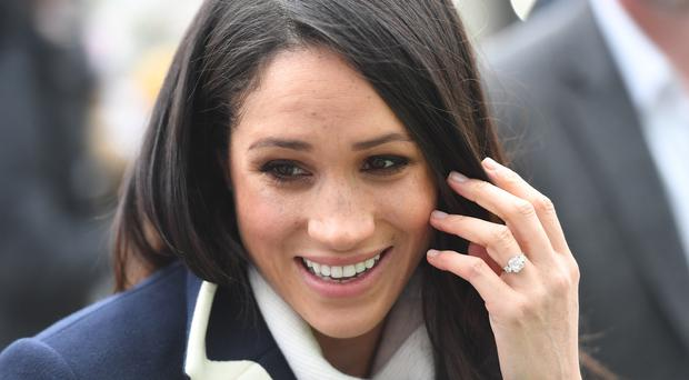 Meghan Markle, with her engagement ring on display, will soon be wearing a wedding band.(Victoria Jones/PA)