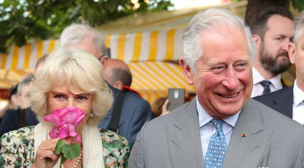 The Duchess of Cornwall and Prince of Wales tour Nice Flower Market (Andrew Matthews/PA)