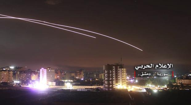 Israeli missiles hit air defence position and other military bases, in Damascus (AP)
