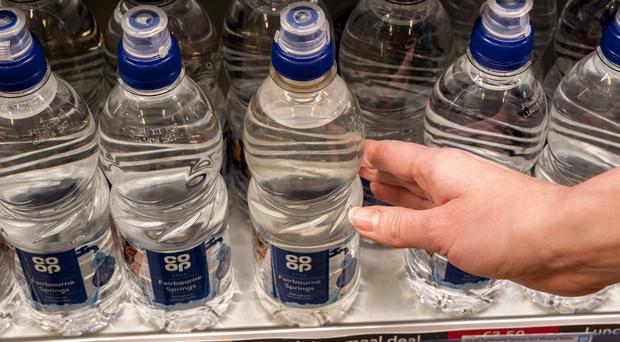 Bottles collected in the Co-op's trial deposit return scheme will be recycled for its own brand bottled water (Co-op/PA)