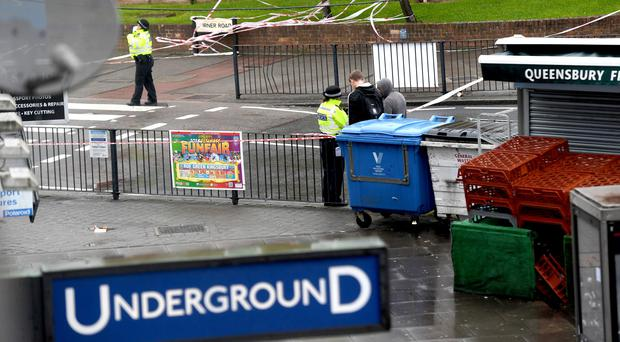 Police activity by a cordon in Queensbury, north-west London, near where Leon Maxwell was shot dead (Victoria Jones/PA)
