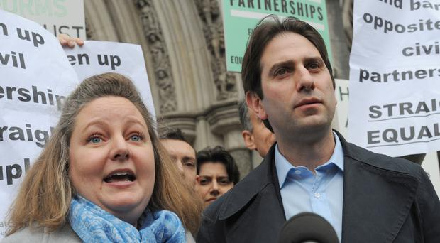 Rebecca Steinfeld and Charles Keidan outside the Royal Courts of Justice, London, after they lost their Court of Appeal fight to enter a civil partnership (PA/Charlotte Ball)